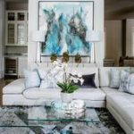 A white modern sectional with leather tufting balances simplicity with comfort i