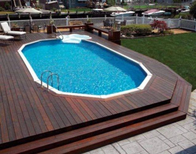 I love how they buried this above ground pool then decked around .