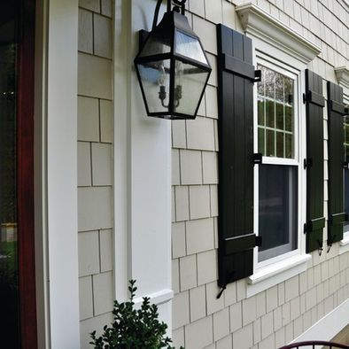 Hardie color - COBBLESTONE w/ black shutters and lantern .