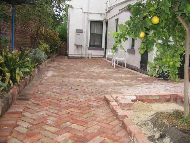 Recycled red brick paving in herringbone pattern | Brick paver .