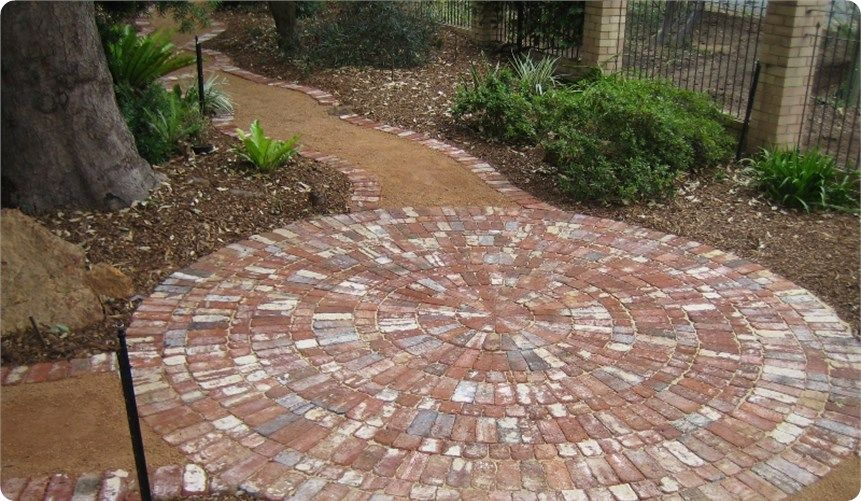 Copy of Recycled brick circle to break a path and create a focus .