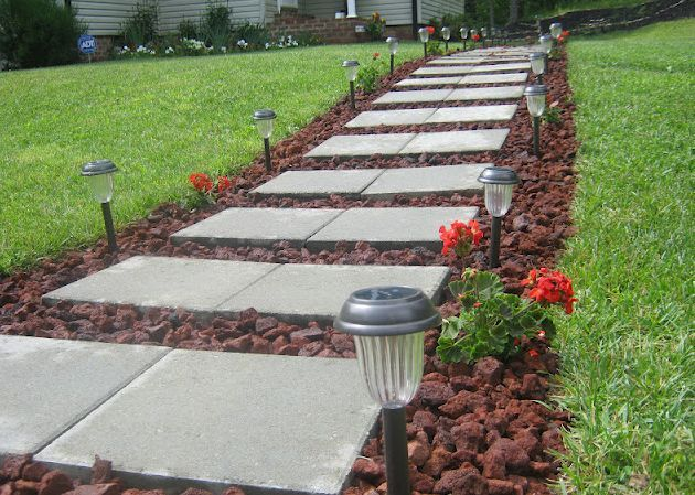 Front Walkway built out of inexpensive cement pavers, red lava .