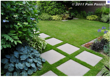 Square concrete stepping stones....but with dwarf monkey grass .