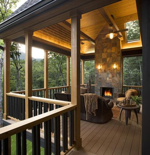 Covered deck with fireplace. I could hang out here all day .