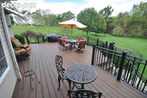 Beige house, brown deck, black rails | Deck colors, Tan house .