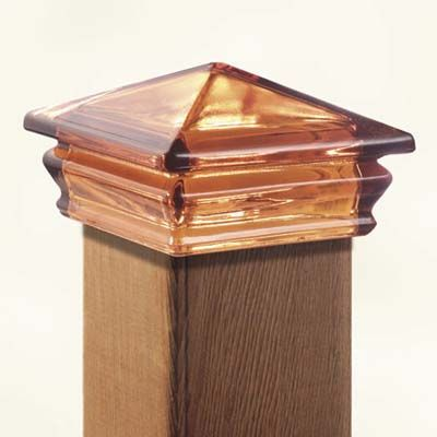 Jewel-toned, pyramid-shaped glass deck post caps add a soft .