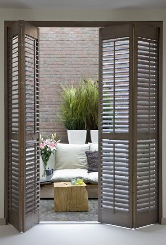 Interior folding wooden door shutter RUSTIQUE JASNO SHUTTERS .