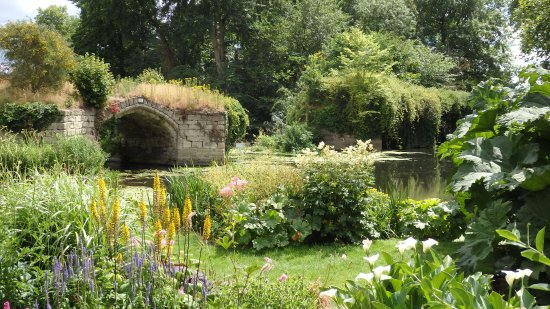 the garden borders onto the mill pond of the castle's mill and the .