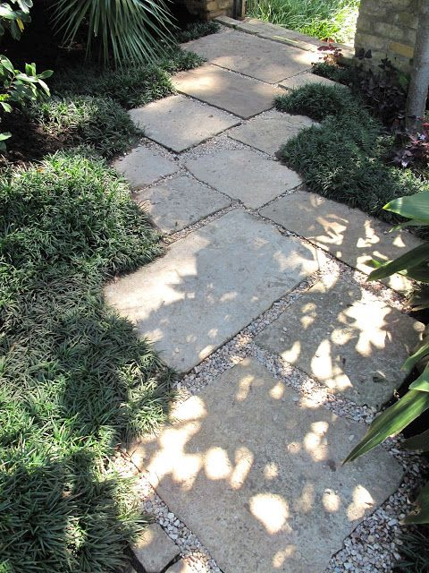 Stone or concrete pavers as a garden path | Side yard landscaping .