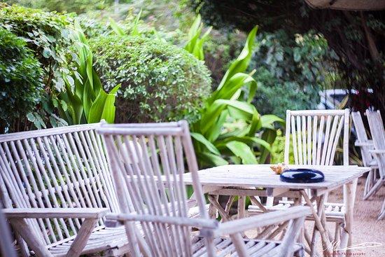 Cozy garden seating - Picture of La Taverna Italian Restaurant .