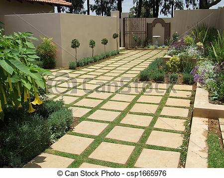 Square tiles in the garden. Garden and landscaping ide
