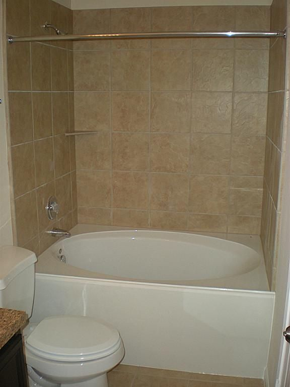 Master bathe with garden tub and shower combo. | Bathtub shower .