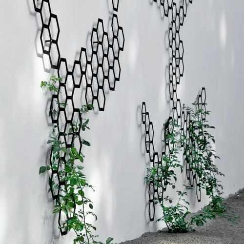 25 Incredible DIY Garden Fence Wall Art Ide