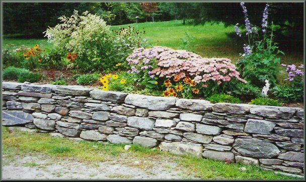 Dry stone garden wall -- this is a retaining wall but the idea is .
