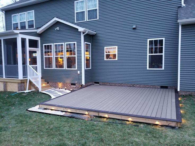 Diy ground level composite deck. Led lighting. Stone border – 2019 .