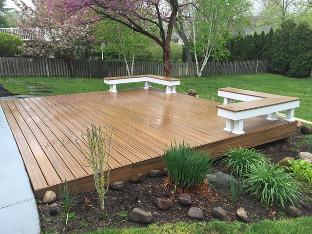 Ground level transcend deck with built in seating - Modern - Deck .