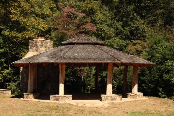 Large riverside gazebo with stone fireplace at Doe River Gor