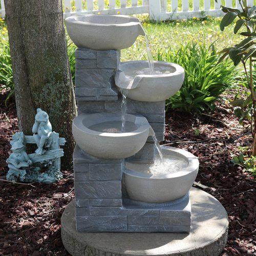 Serenity Health's outdoor backyard water fountains & outdoor patio .