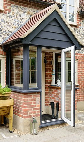 enclose your front porch to make a double entry and regulate the .