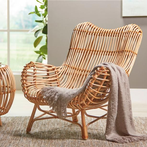 Remarkably comfortable and supportive, our curving Sairah Rattan .