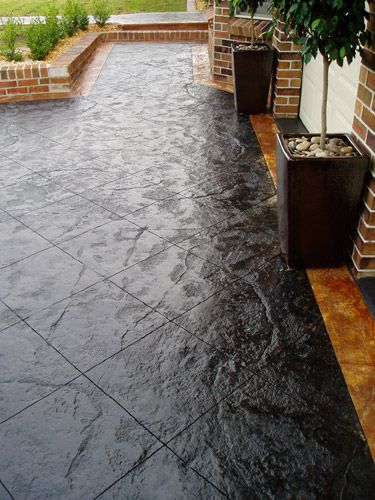 Stamped & Black stained concrete patio   Concrete stain patio .