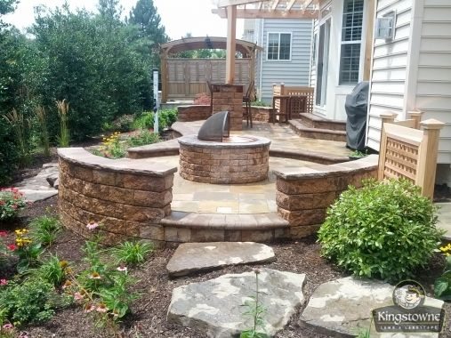 Stunning 2 level paver patio with block seat wall, fire pit .