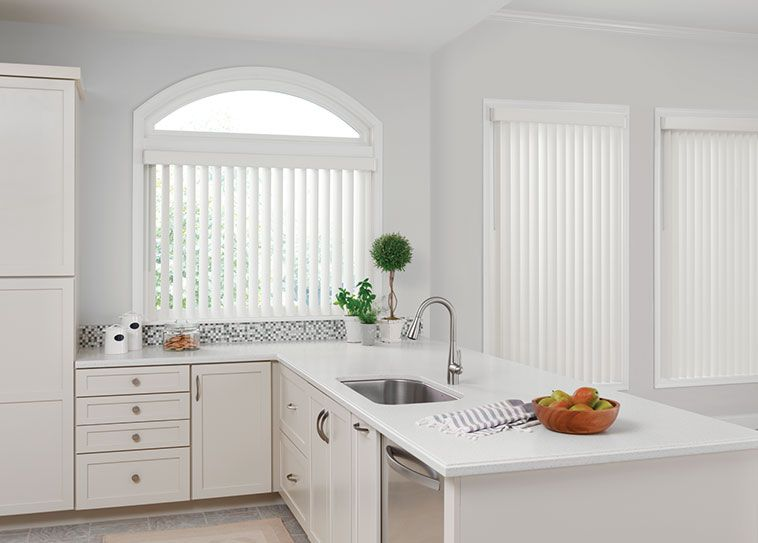 All white #verticalblinds complement existing decor. | Vertical .